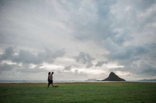 couple with chinaman's hat in backdrop