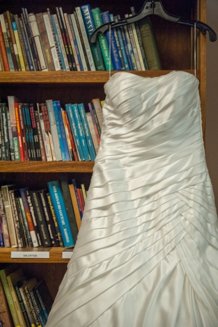 brides dress on bookshelf