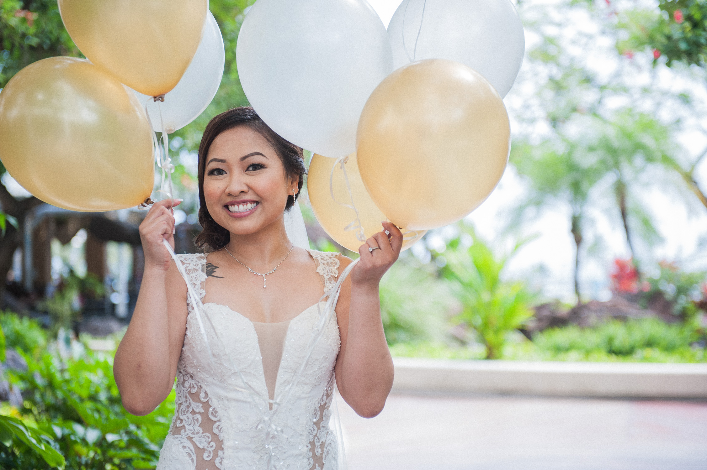 Bride with white and gold balloons at Ilikai Hotel