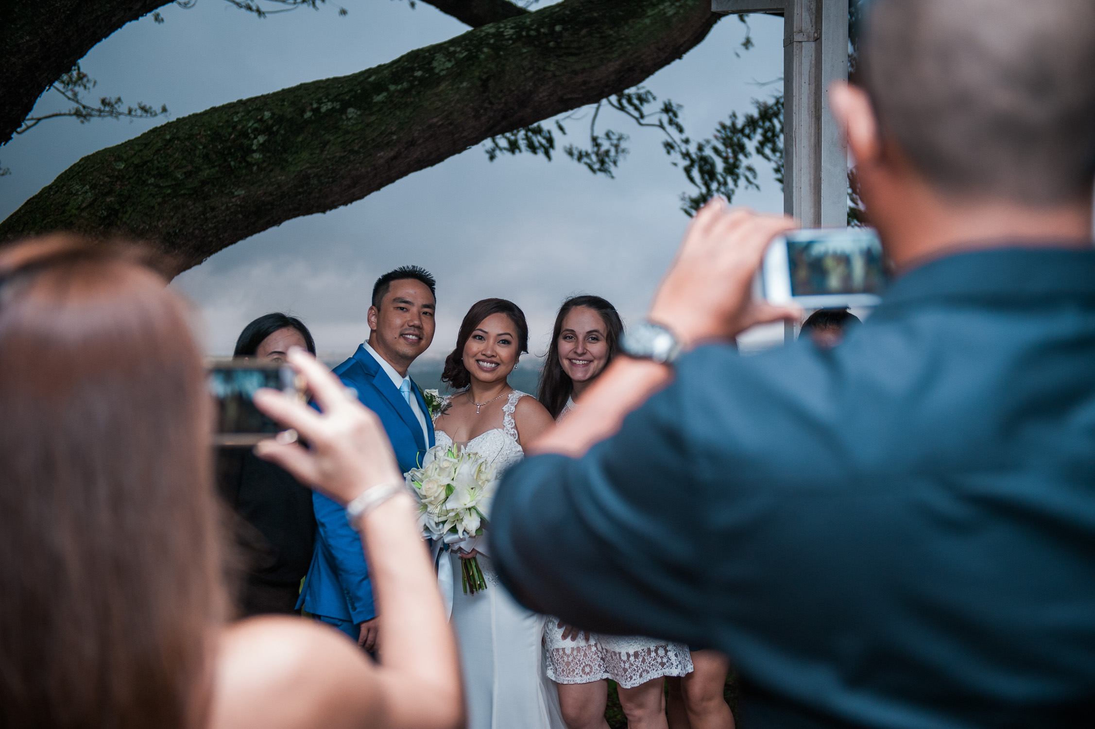 Bridal party taking photos with guests