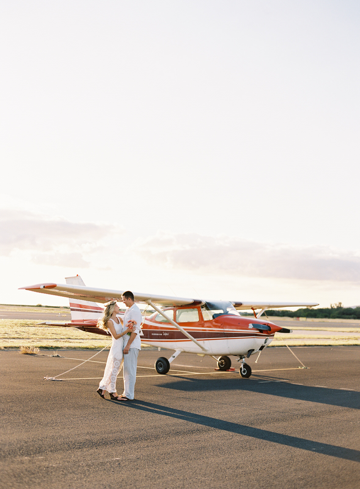 Couple with small plane