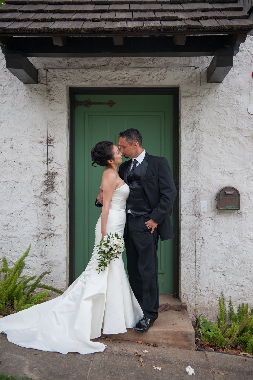 Bridal couple in front of green door