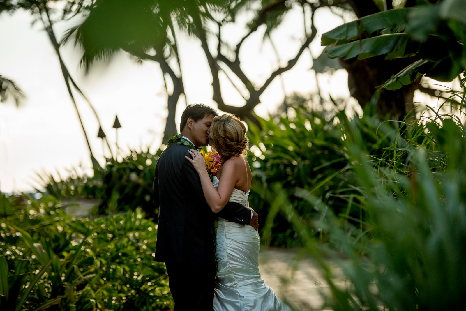 Couple Kissing in greenery