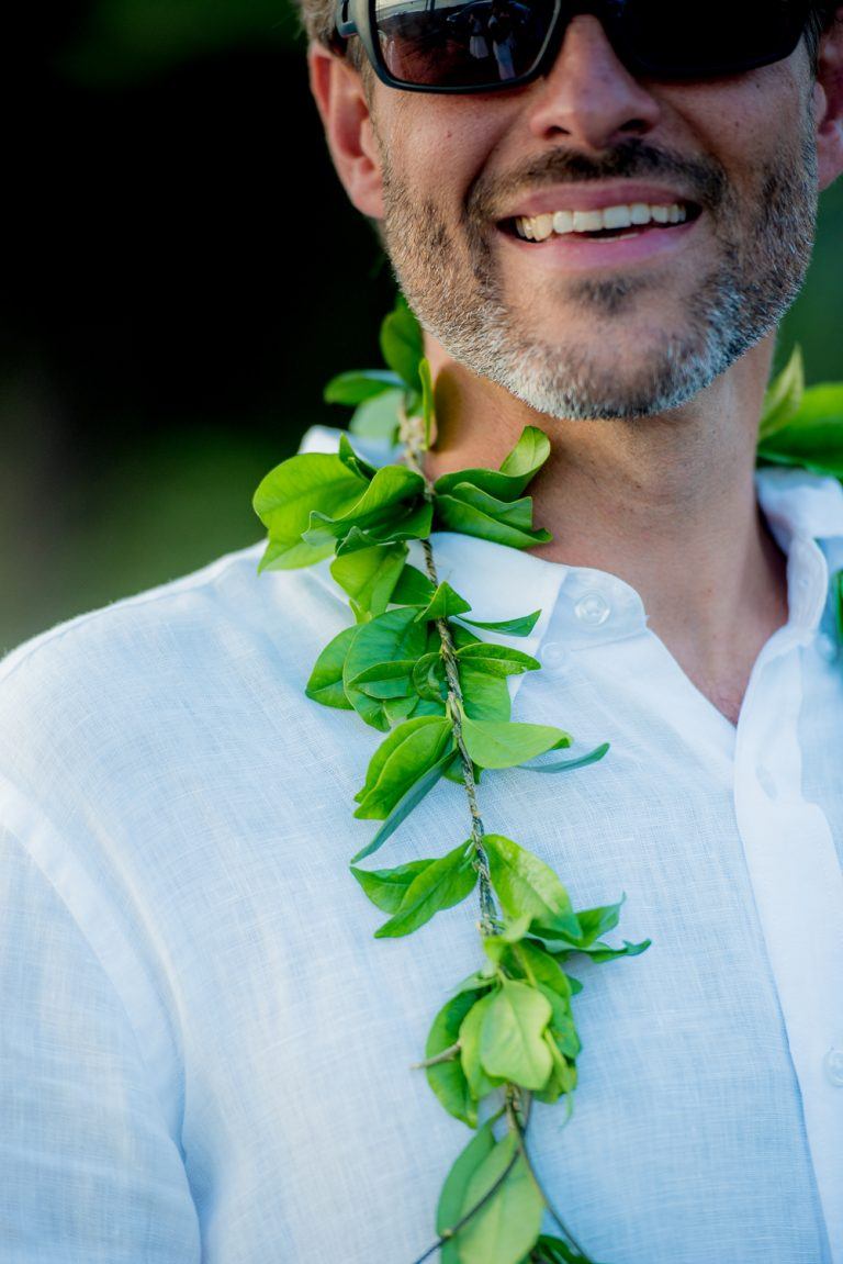 Close up of grooms maile lei