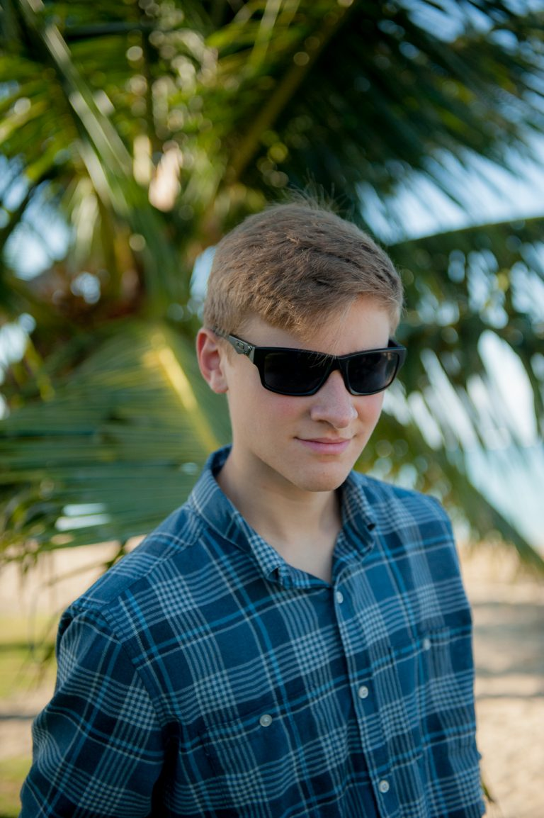 Senior at Ala Moana beach with sunglasses