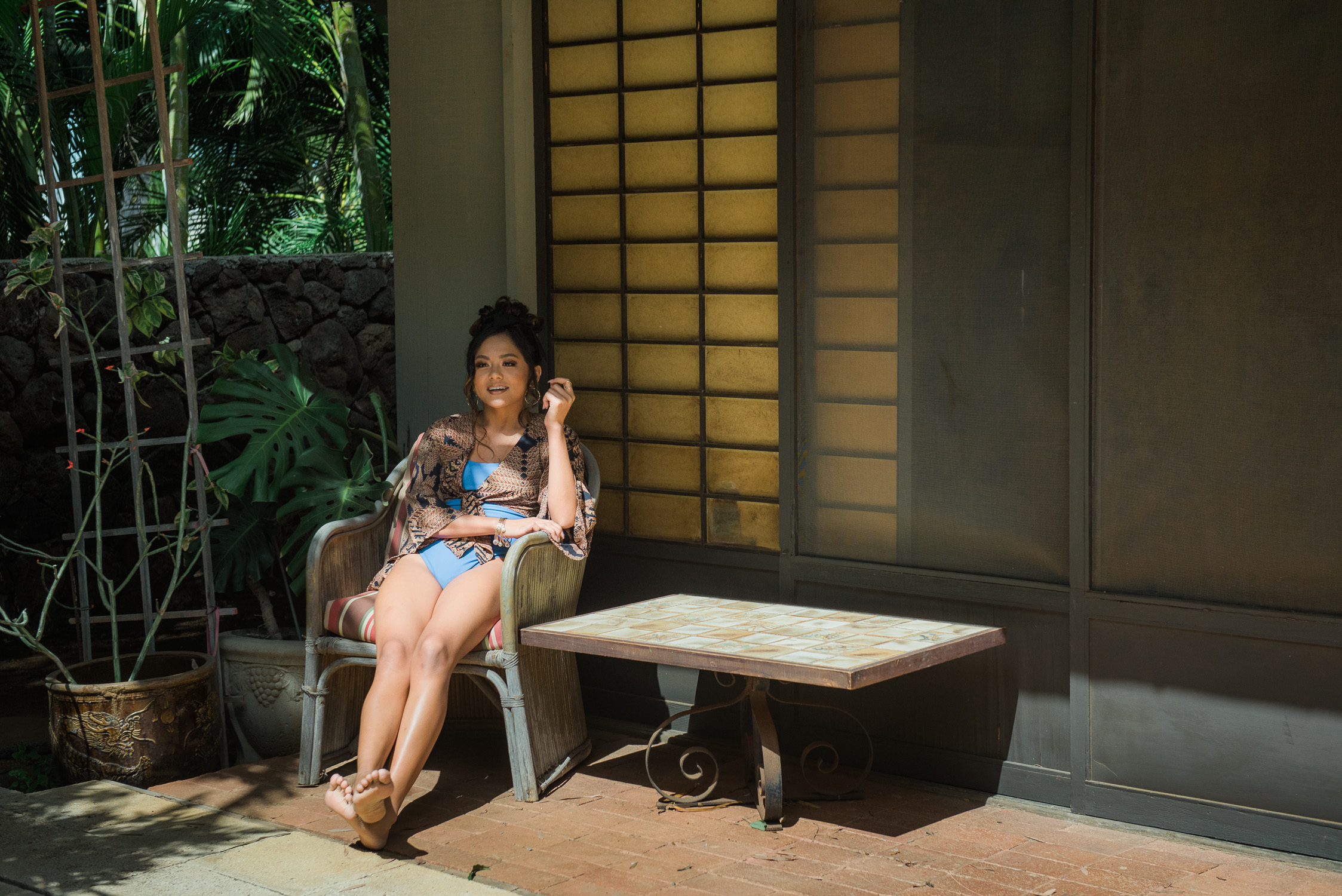 Swimsuit model sitting by Japanese shoji panels