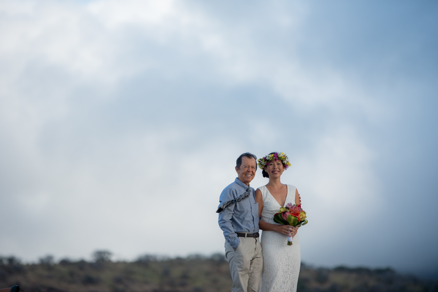 Father and daughter waiting to walk down aisle - with big sky behind them