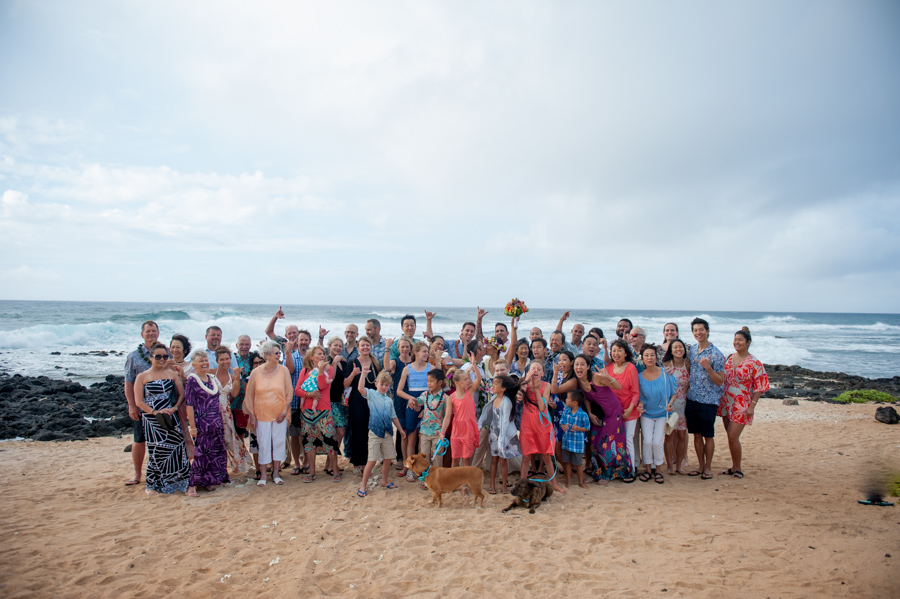 group photo of wedding at sandy beach, oahu