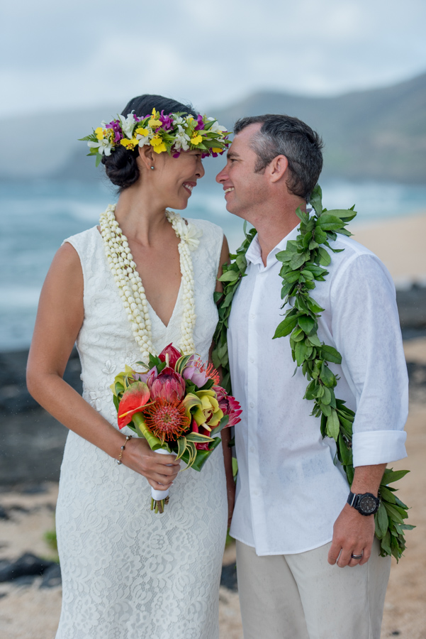close up of bride and groom on hawaii beach