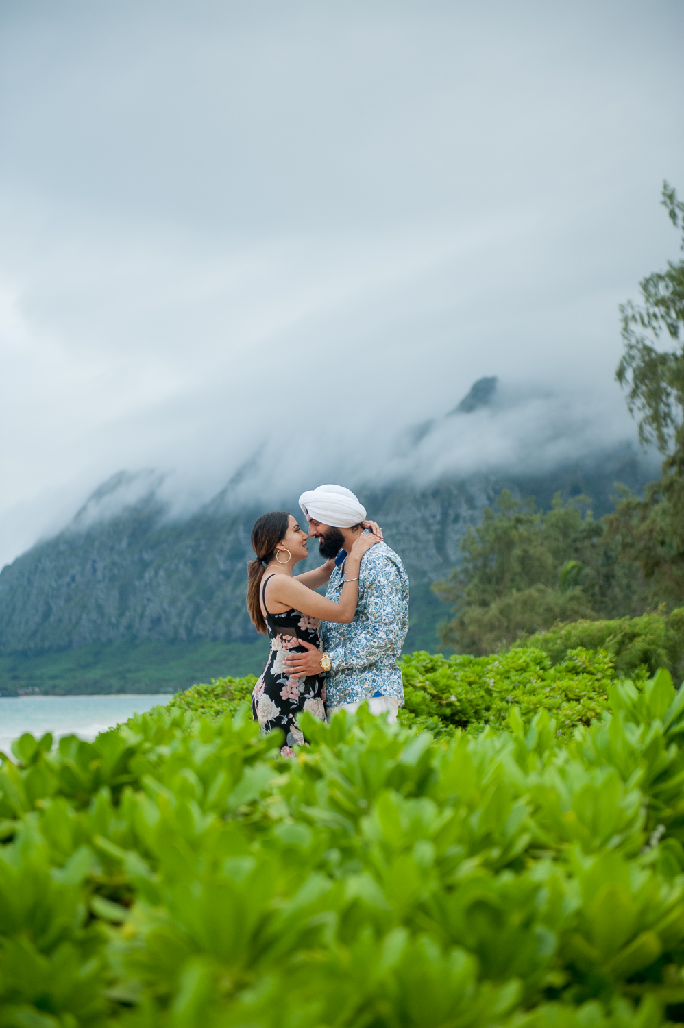 Indian Couple at Waimanalo Beach with mountains in background