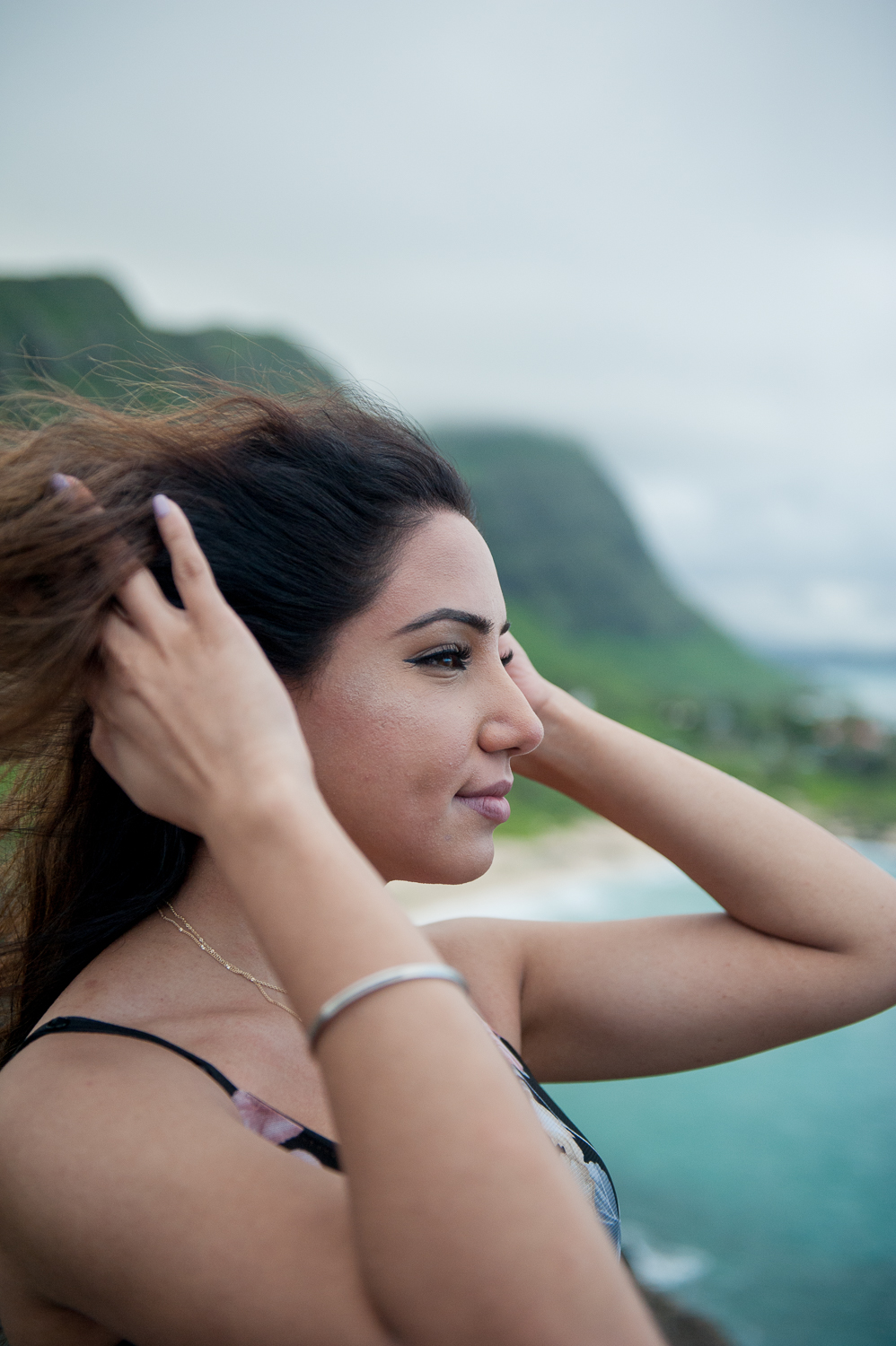 Woman Playing with hair at windy Makapuu Lookout