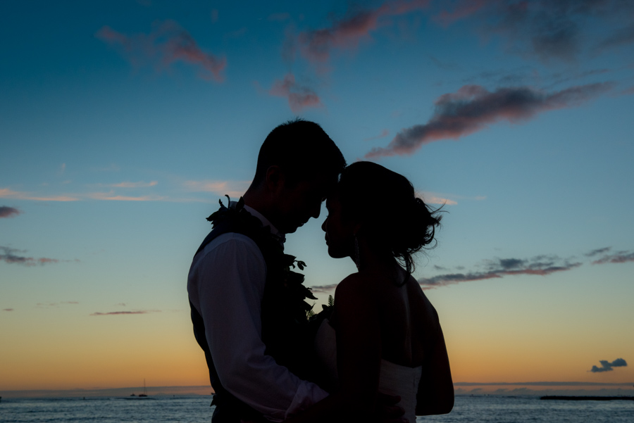 Bridal Couple silhouette on Waikiki Beach at Sunset