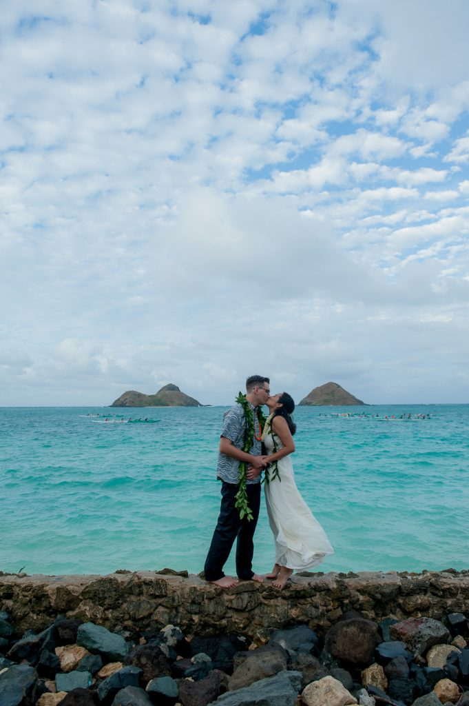 Bridal couple in front of Mokulua Islands