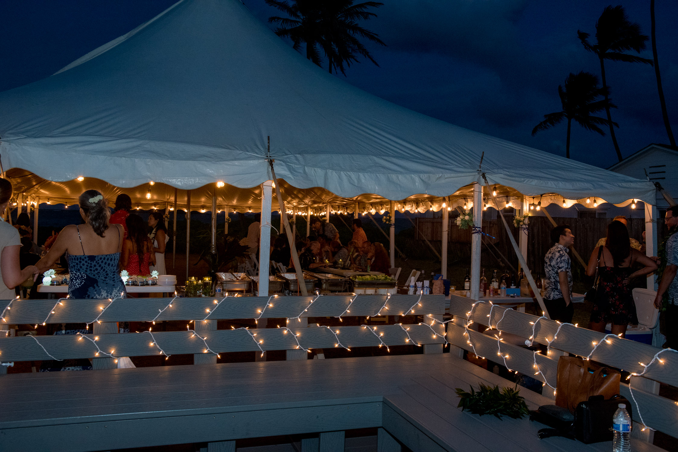 Lights on tent at evening reception