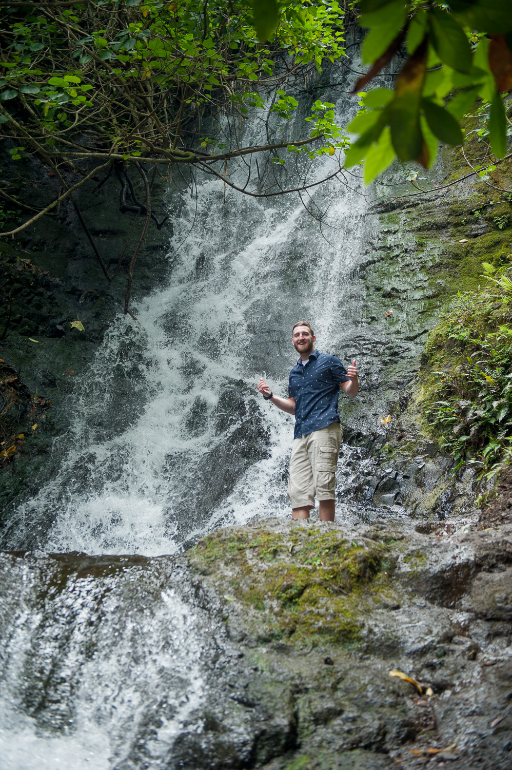 Man standing in front of Likeke Waterfall