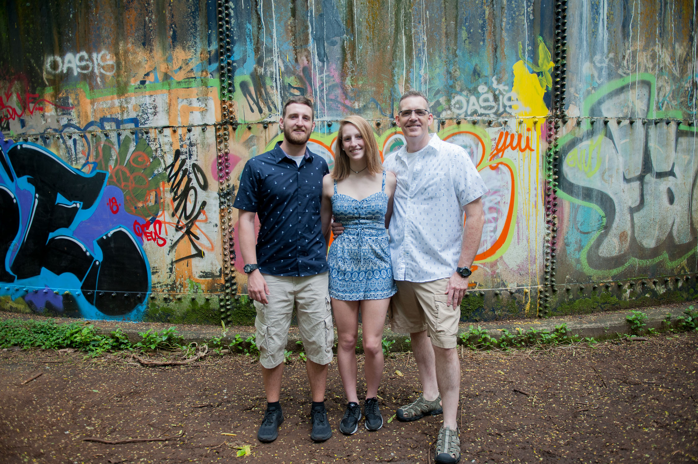 Family Photo in front of grafitti in kaneohe