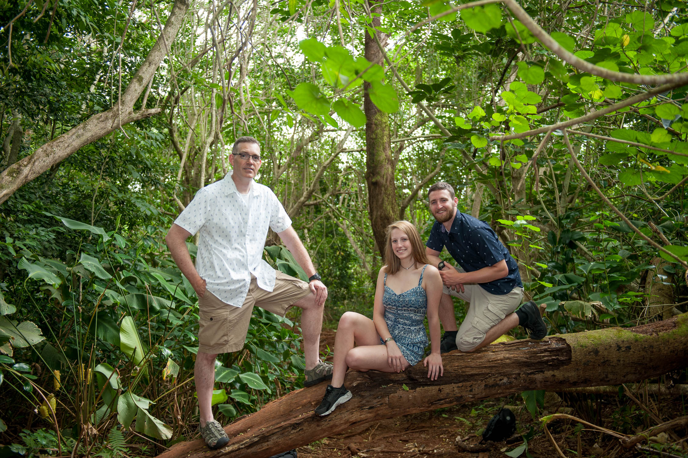 Family Photo on downed tree on way to Oahu waterfall