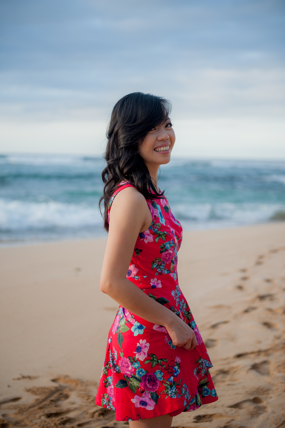 Photo of woman in red dress on North Shore beach
