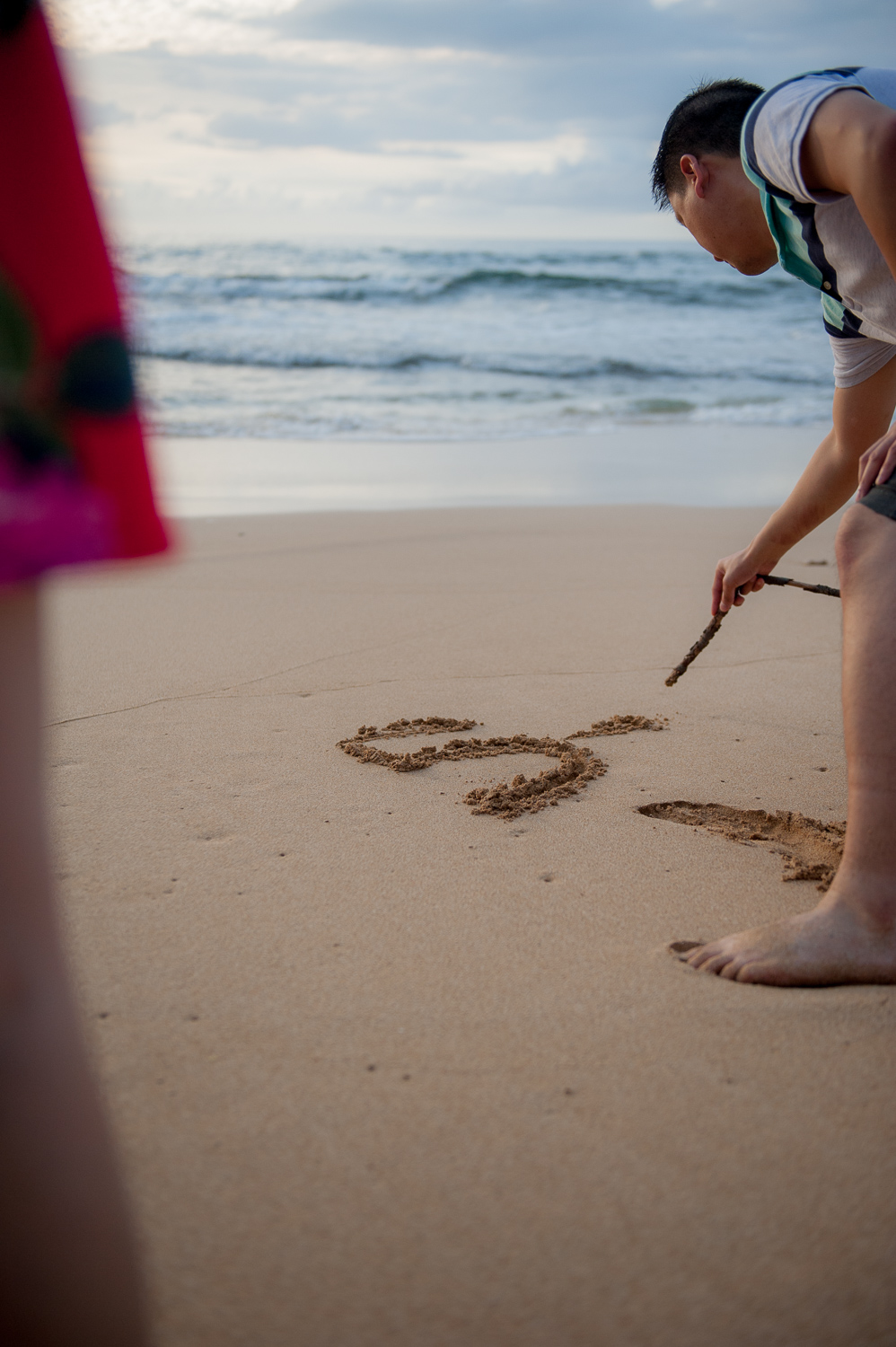 Spelling words on beach with a stick