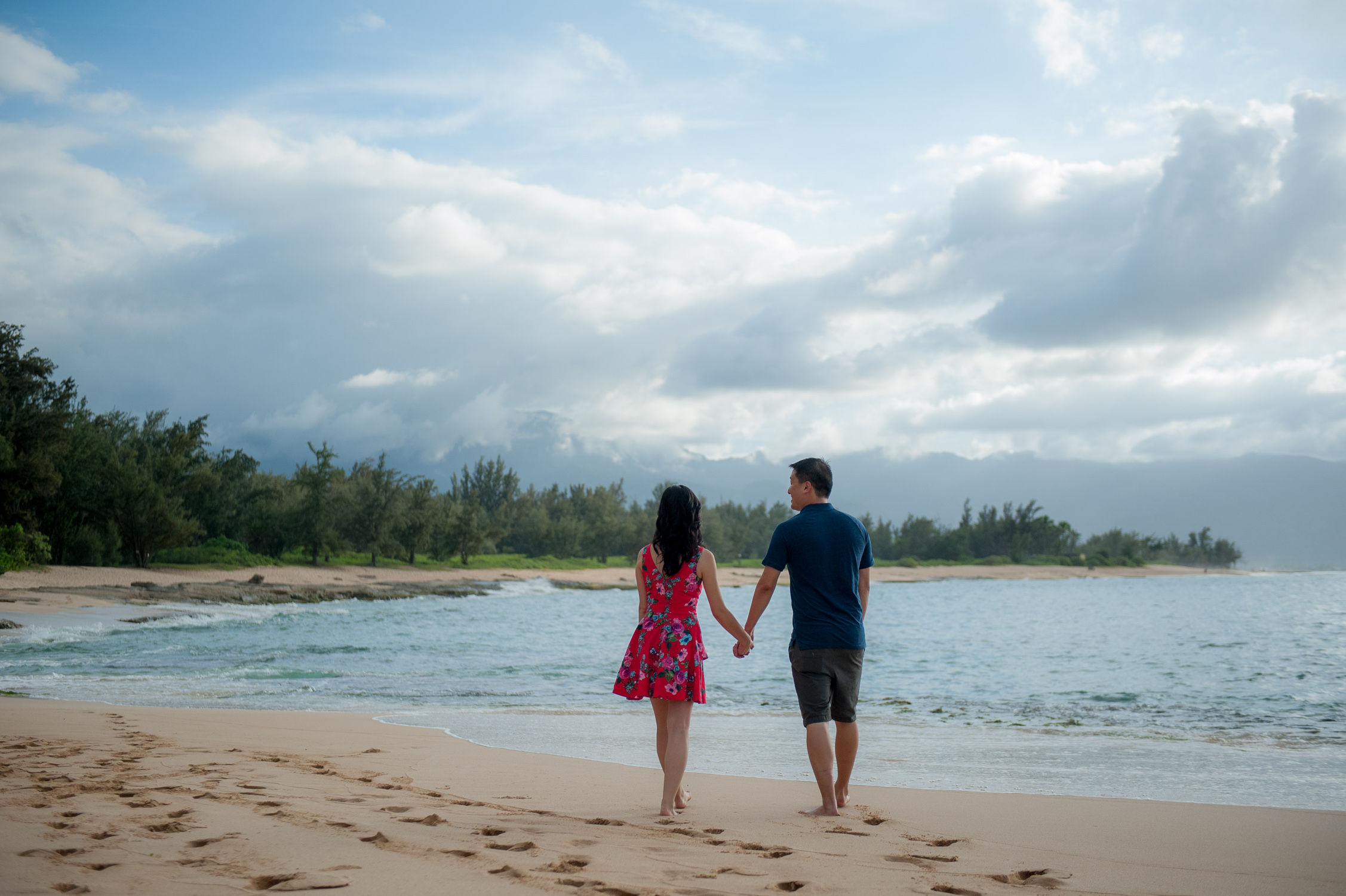 Walking down a North Shore beach, hand in hand