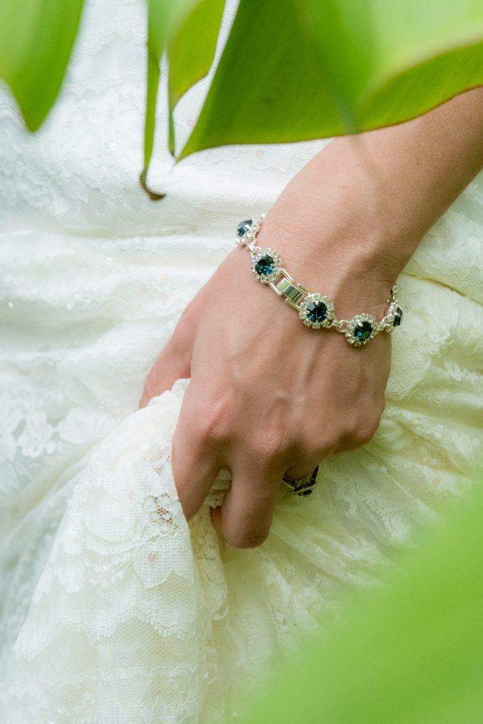 Blue bracelet detail on bride