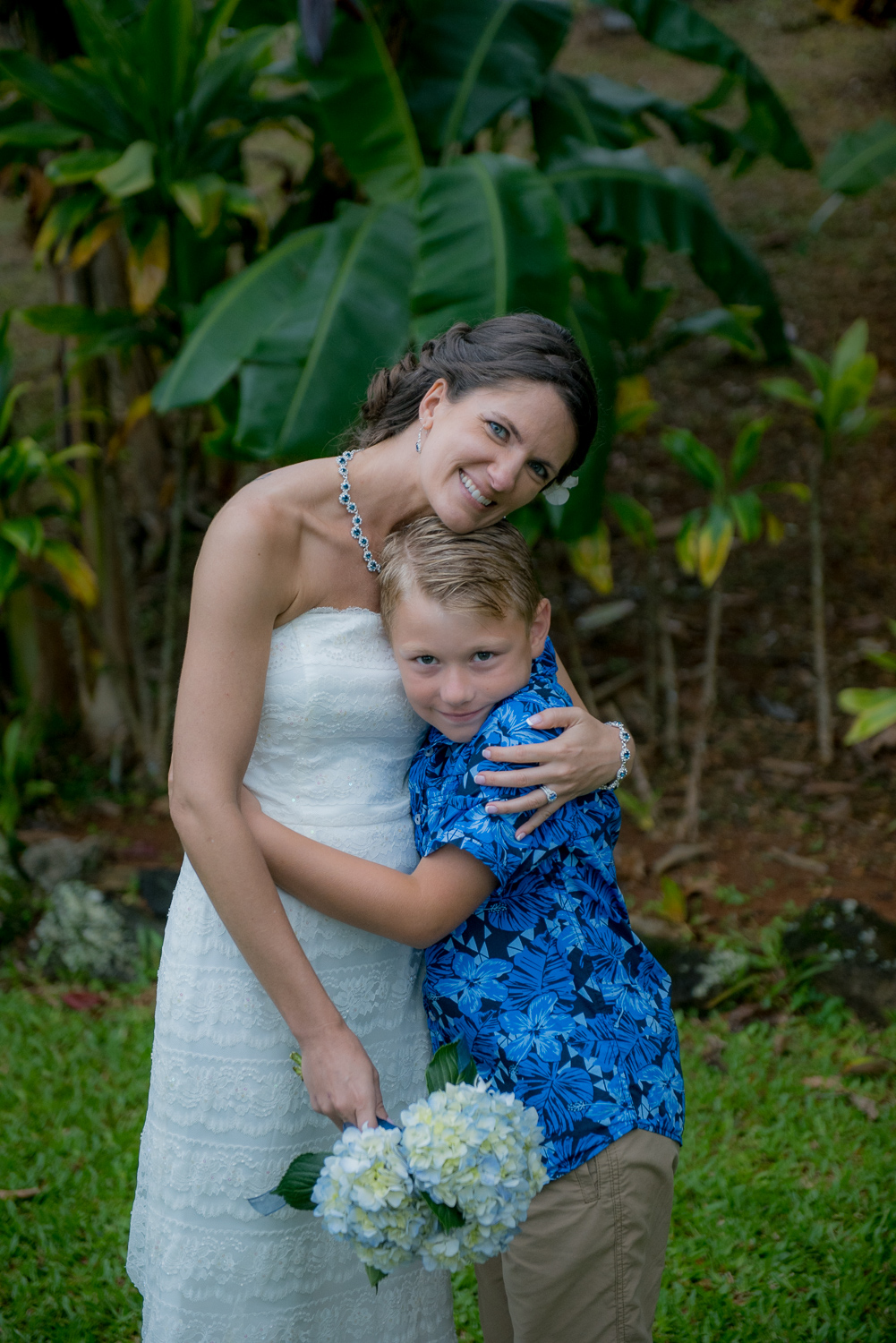 Bride and young boy guest at Heeia Pier Wedding