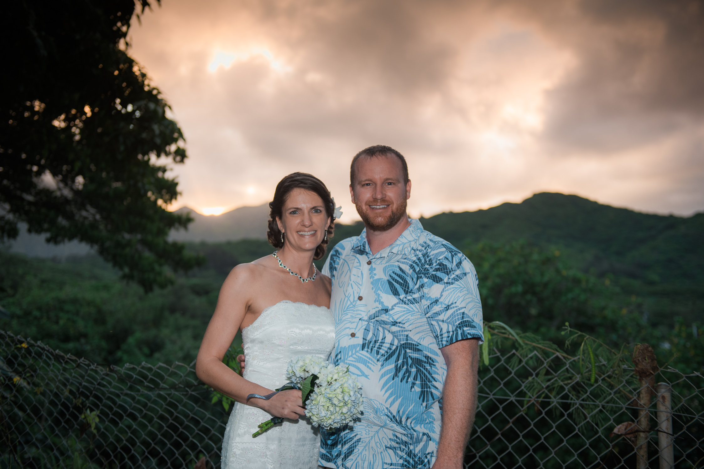 Couple with Kaneohe sunset over Koolau mountains