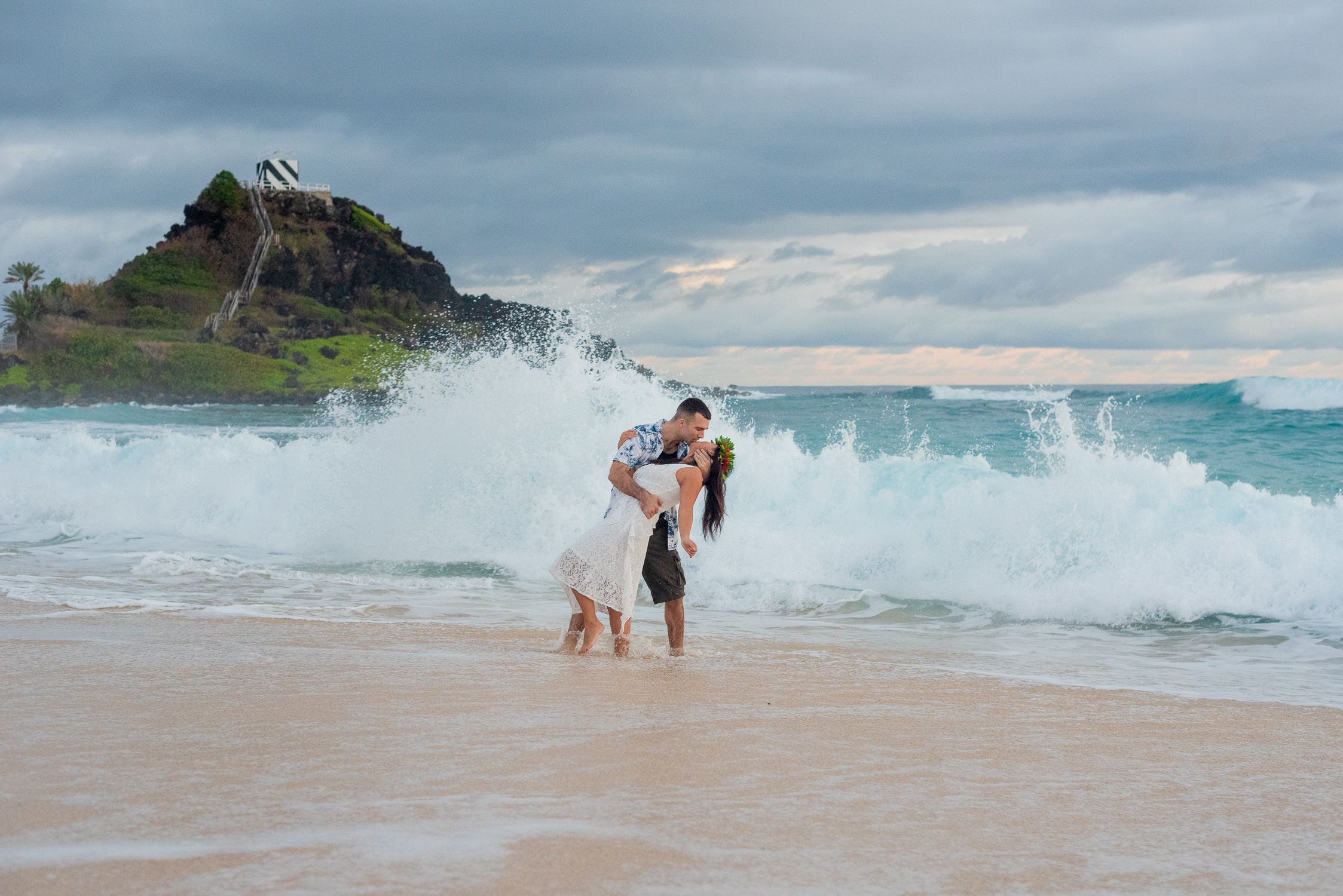 Big wave at Pyramid Rock with couple engagement photography session