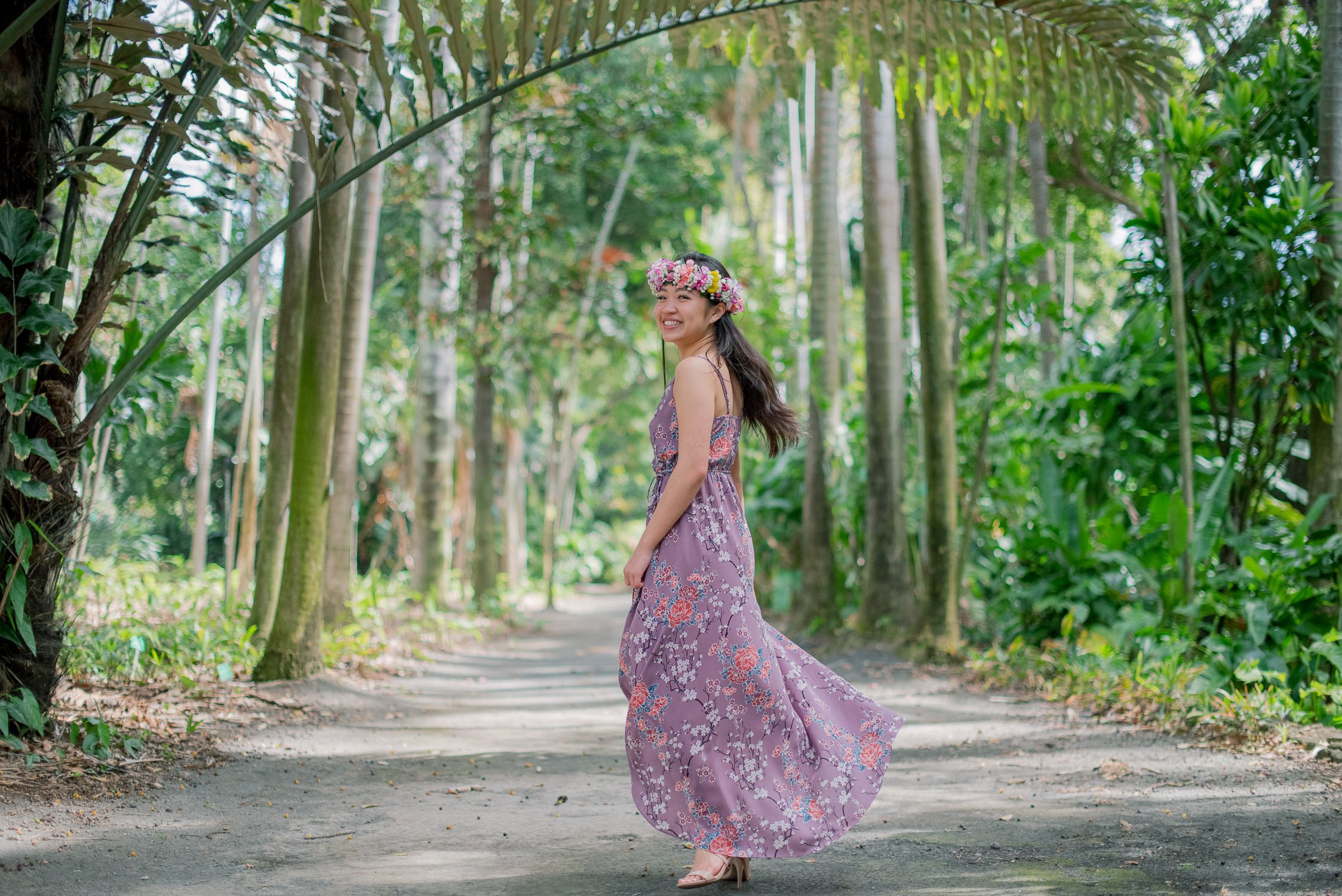 Walking around Foster Botanical Garden- high school girl in purple dress and haku lei