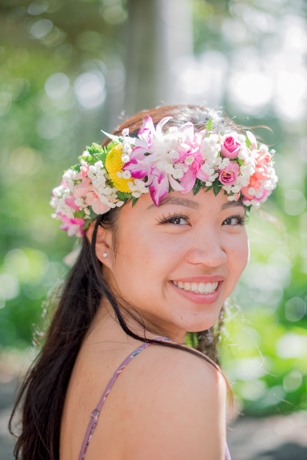 Close up of girl and haku lei at Foster Botanical Garden