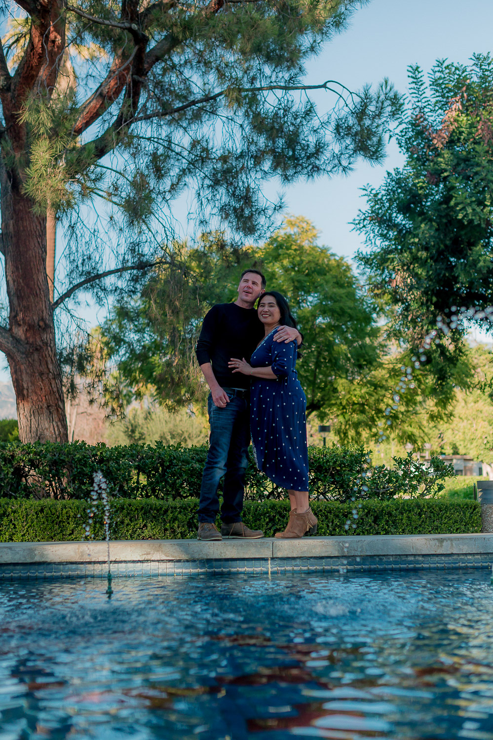 Couple in front of water garden
