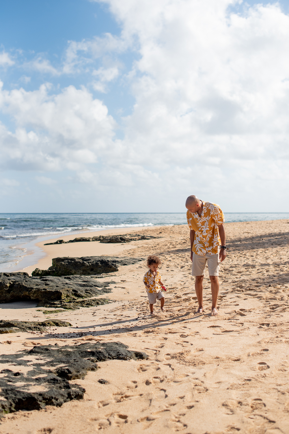 Father and son walking down North Shore Secret Beach