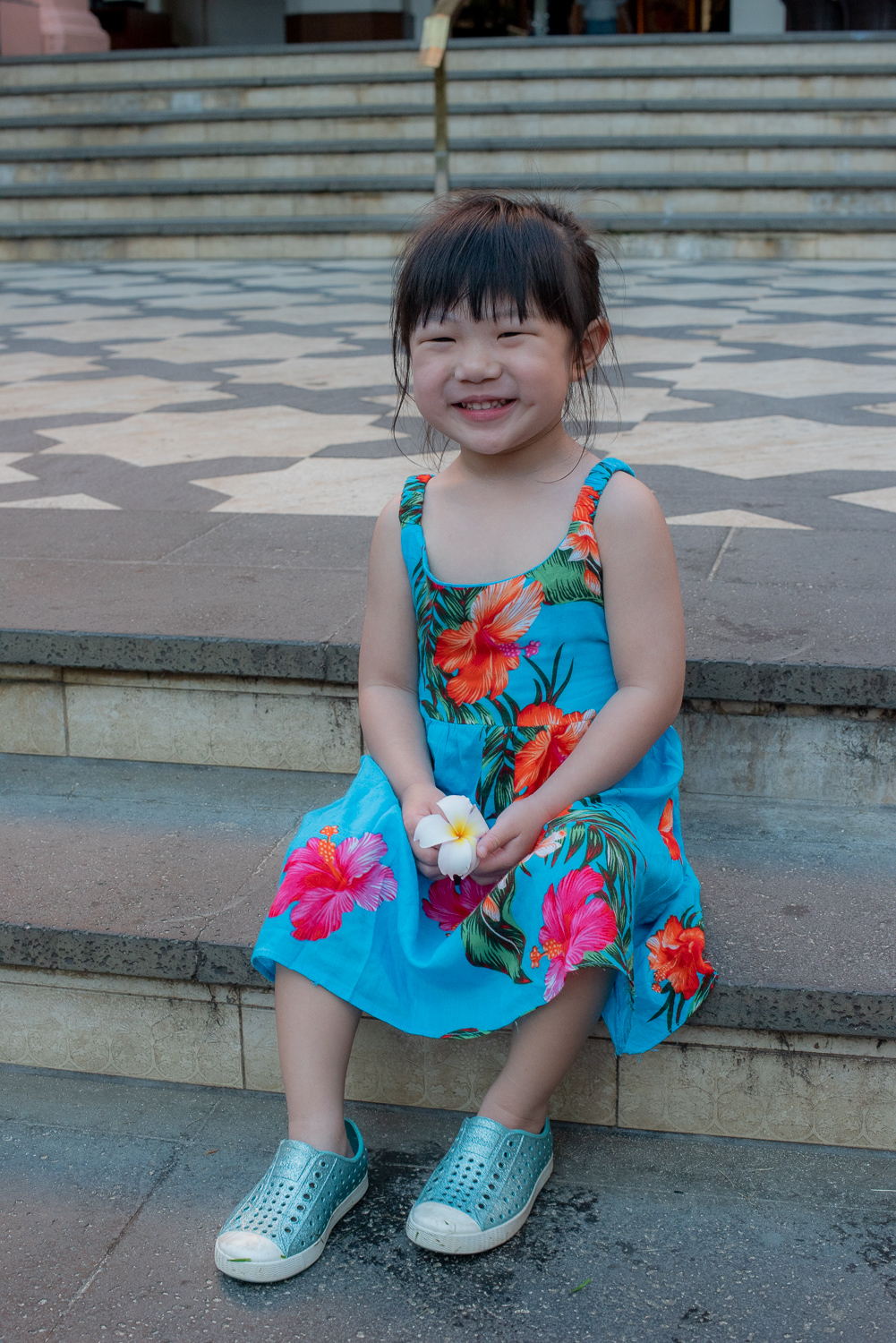 Small girl sitting on Royal Hawaiian steps