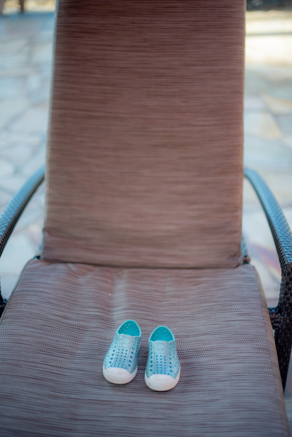 Little blue shoes on chair