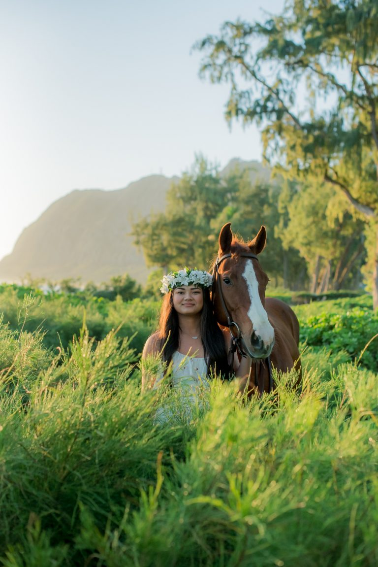 Girl with horse in brush