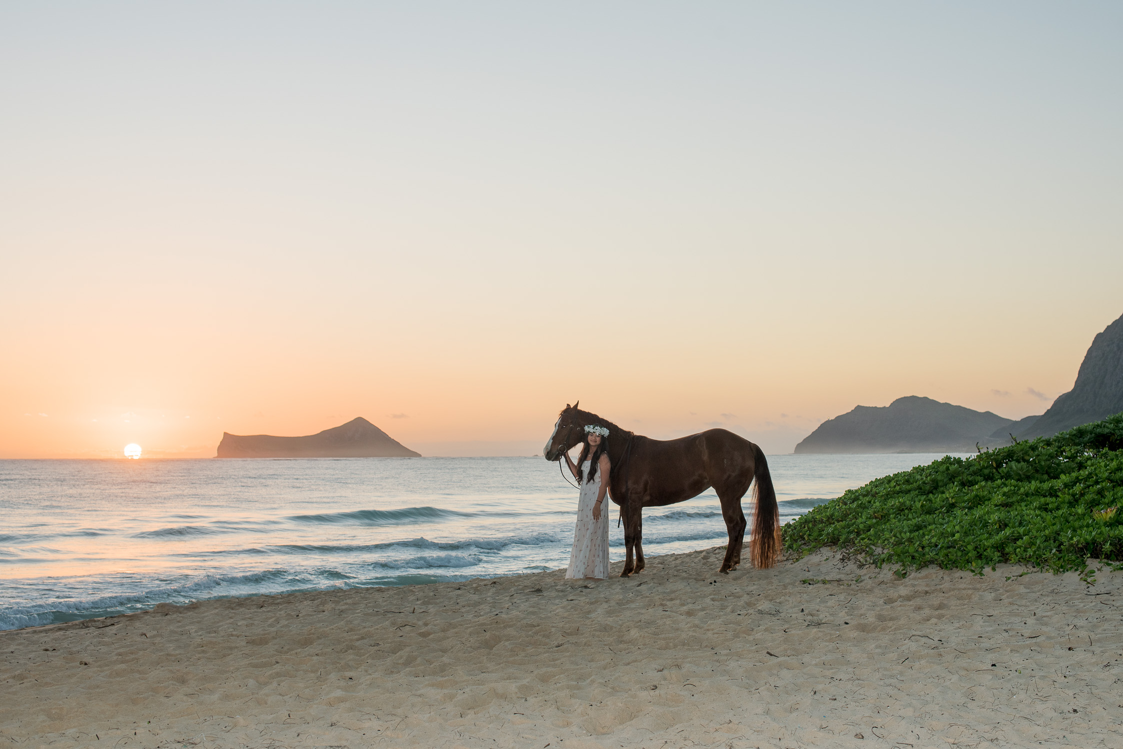 Waimanalo beach with girl and horse