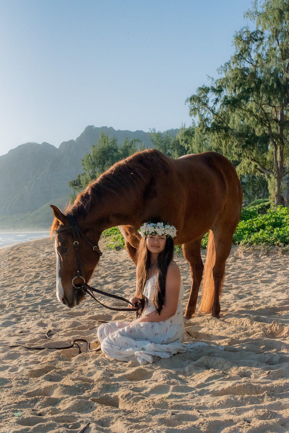 Girl with horse on Waimanalo beach