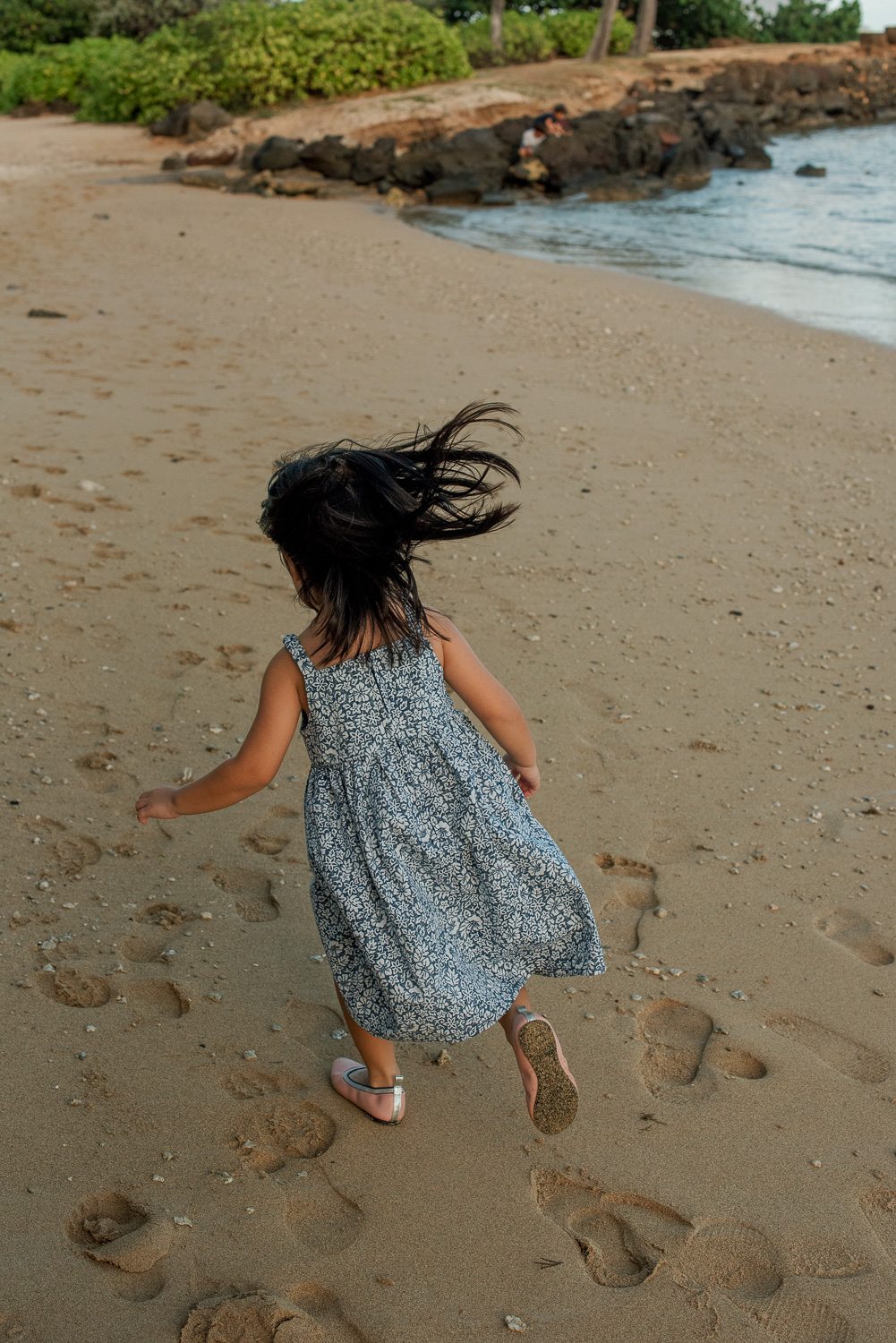 little girl running down waialae beach
