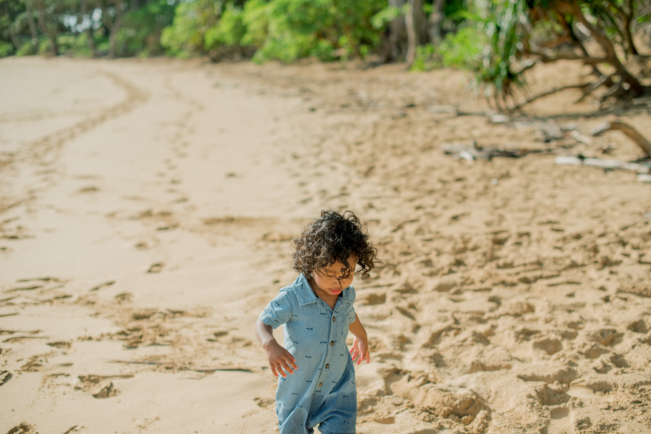 3 Year old walking on beach